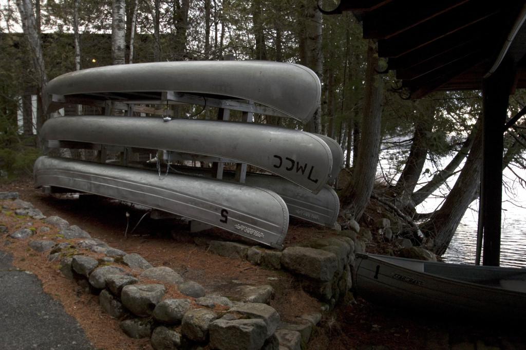 Canoes on a rack near a lake