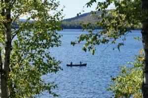 People canoeing on lake